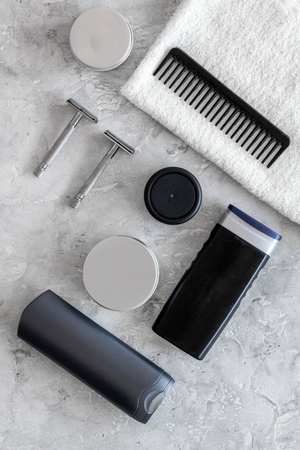 Cosmetics for men on grey stone background top view.