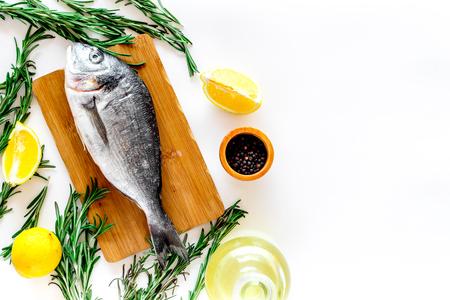 Fresh dorado fish ready to cook on white background top view.