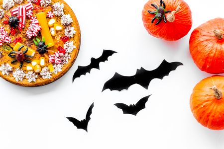 Pie for halloween with gummy spiders on white background top view. Stock Photo