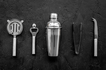 Instruments bartender on black background top view. Stock Photo