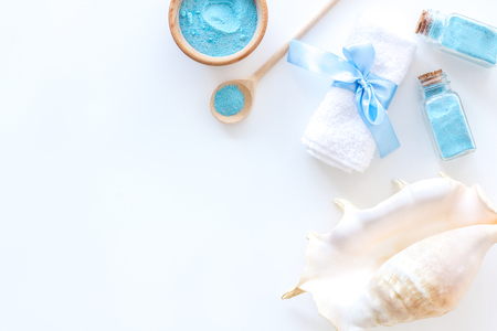 Cosmetic set with bath salt and shell from dead sea on white background top view space for text