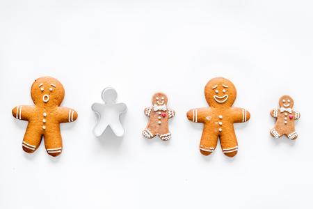 retro christmas: Gingerbread cookies of different shapes on white table background top view mock up