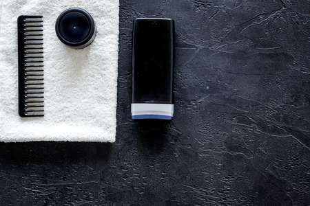 Cosmetics for men on black background top view. Stock Photo