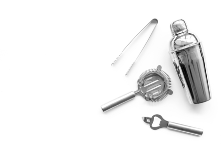 Barman equipment. Shaker, strainer on white background top view. Stock Photo