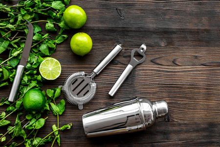 In the bar. Shake mojito. Wooden background top view Stock Photo