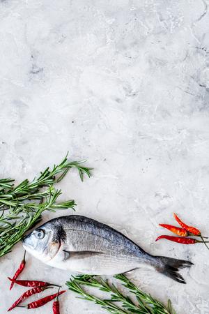 Fresh dorado fish ready to cook on grey background top view. Banco de Imagens