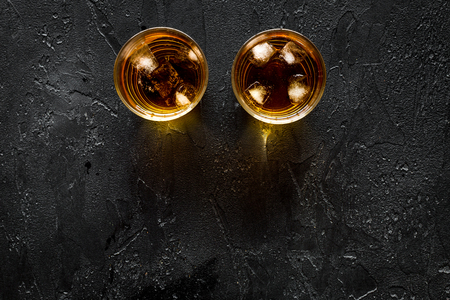Alcohol cocktails with whiskey and ice on black bar background top view mockup Stock Photo
