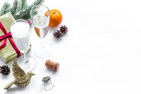 Party with present box, spruce, champagne and glasses to celebrate New Year 2018 on white table background mock-up