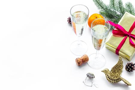 spruce, mandarin, champagne, present and toys for christmas celebration on white desk background mockup Stock Photo