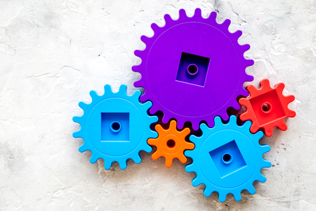bright gears for great technology of team work and correct mechanism on stone background top view copyspace