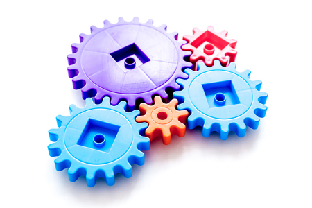 moving forward concept, ideal operating principle with gears and wheels on white background
