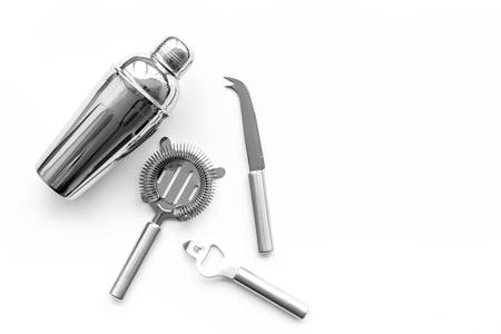 Barman equipment. Shaker, strainer on white background top view. Stock Photo