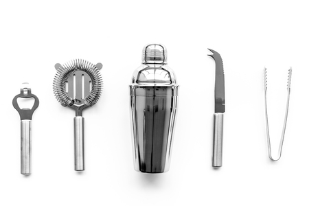 Barman equipment. Shaker, strainer on white background top view. 免版税图像