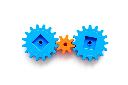 Bright gears for great technology of team work and correct mechanism on white table background top view copyspace Stock Photo