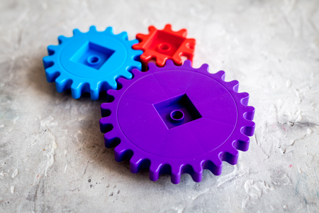 Bright gears for great technology of team work and correct mechanism on stone table background