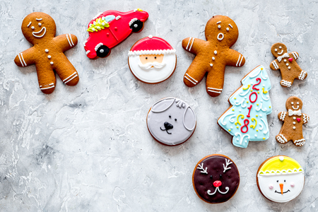 Gingerbread cookies of different shapes on stone background top view.