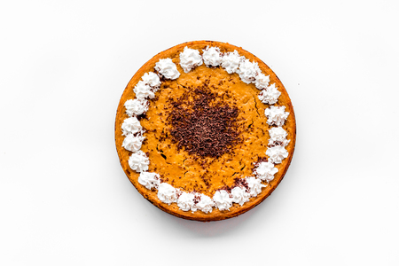 Pumpkin pie for thanksgiving day on white desk background top view. Stock Photo