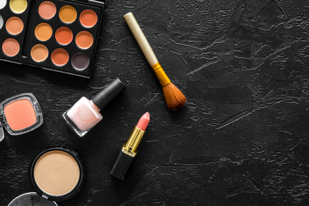 Beige and nude tones cosmetics for natural makeup on black background top view copyspace 版權商用圖片
