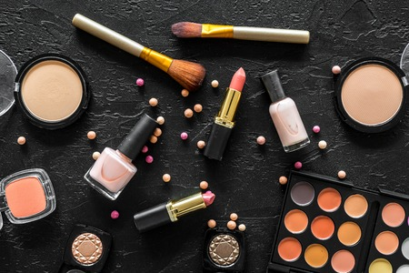 Beige and nude tones cosmetics for natural makeup on black background top view Stock fotó