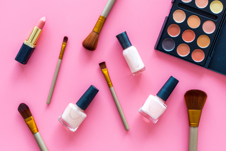 Decorative cosmetic set for natural makeup on pink background top view