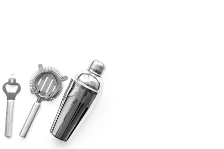 Barman equipment. Shaker, strainer on white background top view copyspace