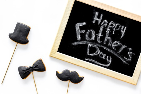 Happy fathers day morning with black tie, mustache and hat cookies for celebrate white background top view Stock Photo