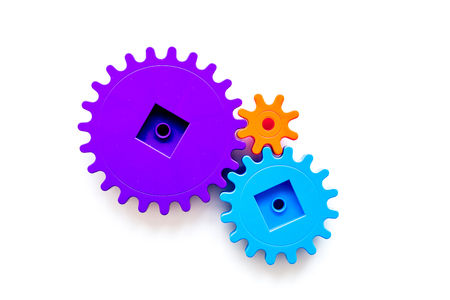 Moving forward concept with gears. Right decision and correct solution. white desk background top view mockup