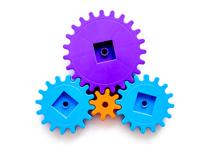 moving forward concept, ideal operating principle with gears and wheels on white background top view