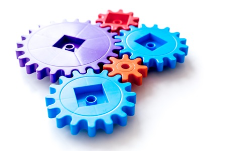 colorful gears for ideal team work technology white table background top view Stock Photo