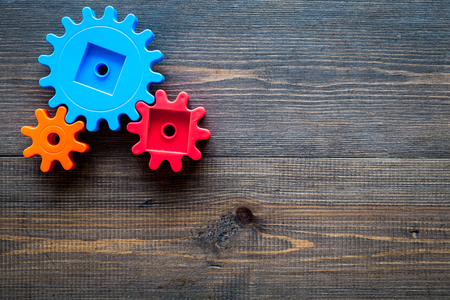 colorful gears for ideal team work technology wooden table background top view mock-up Stock Photo
