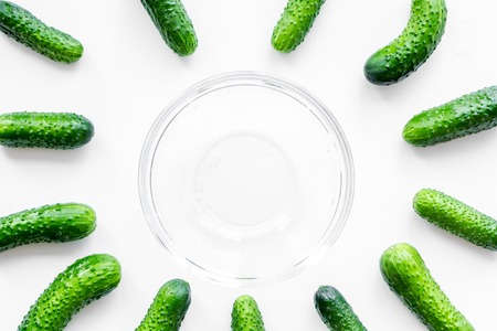 Fresh cucumbers pattern with bowl on white background top view Stock Photo