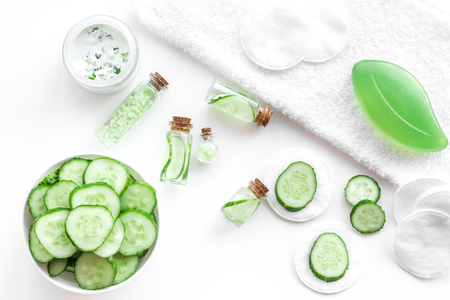 Fresh organic cosmetics with cucumber. Cream and lotion on white background top view