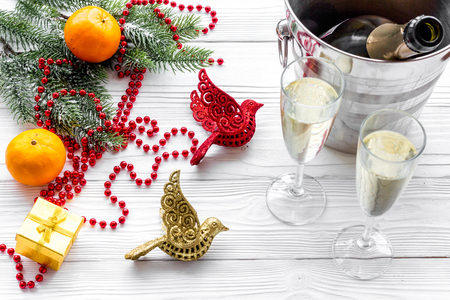 New Year 2018 background. Champagne in bucket, glasses with beverage, tangerines and decoration on grey background Stock Photo