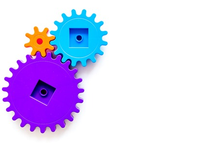 colorful gears for ideal team work technology white table background top view mock-up