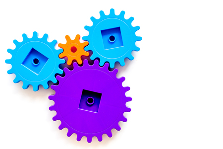 moving forward concept, ideal operating principle with gears and wheels on white background top view mock up