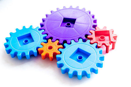 Moving forward concept with gears. Right decision and correct solution. on white desk background