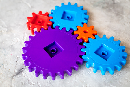 operating table: colorful gears for ideal team work technology stone table background