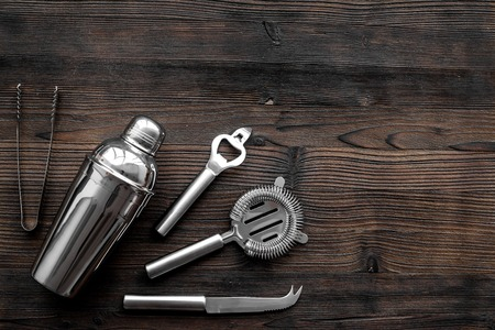 Instruments bartender. Shaker, strainer on wooden background top view copyspace Stock Photo