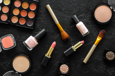 Beige and nude tones cosmetics for natural makeup on black background top view 版權商用圖片