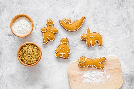 Make gluten free healthy food. Yoga asanas cookies near desk, flour and wheat on stone background top view Stock Photo