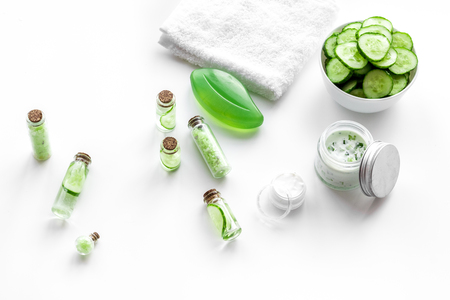 Fresh organic cosmetics with cucumber. Cream and lotion on white background