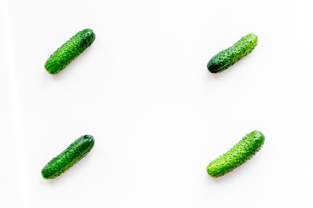 Fresh cucumbers pattern on white background top view copyspace Stock Photo