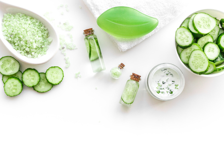 Fresh organic cosmetics with cucumber. Cream, lotion, spa salt on white background top view copyspace Reklamní fotografie