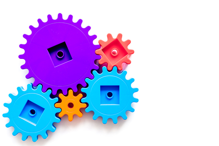 Moving forward concept with gears. Right decision and correct solution. on white desk background top view mockup