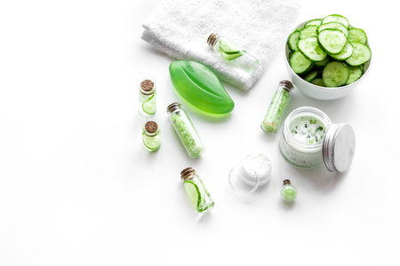 Fresh organic cosmetics with cucumber. Cream and lotion on white background.