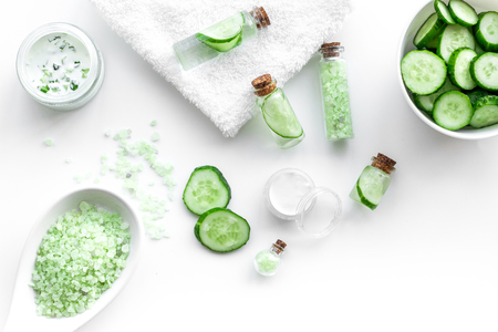 Fresh organic cosmetics with cucumber. Cream and lotion on white background top view. Stock Photo