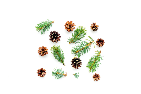 New year symbols pattern. Spruce branches and cones on white background top view. Banco de Imagens - 88463759