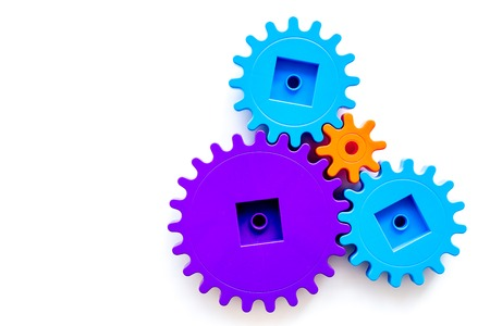 colorful gears for ideal team work technology on white table background top view mock-up