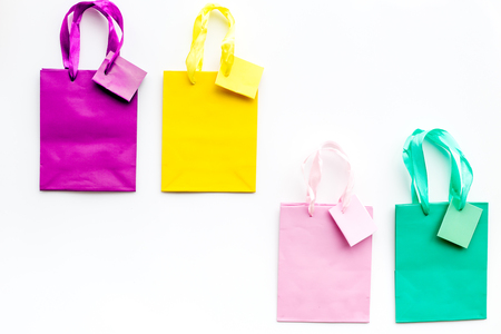 Colored shopping bags on white background top view. Stock Photo