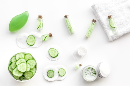 Fresh organic cosmetics with cucumber. Cream and lotion on white background top view. Reklamní fotografie